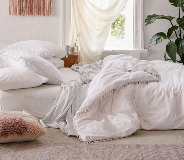 white-tassel-divet-cover-urban-outfitters-e1530809947237.jpg